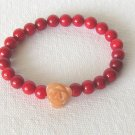 B00004  Handmade strecth beaded bracelet with elastic cord, dyed red coral & carnelian flower