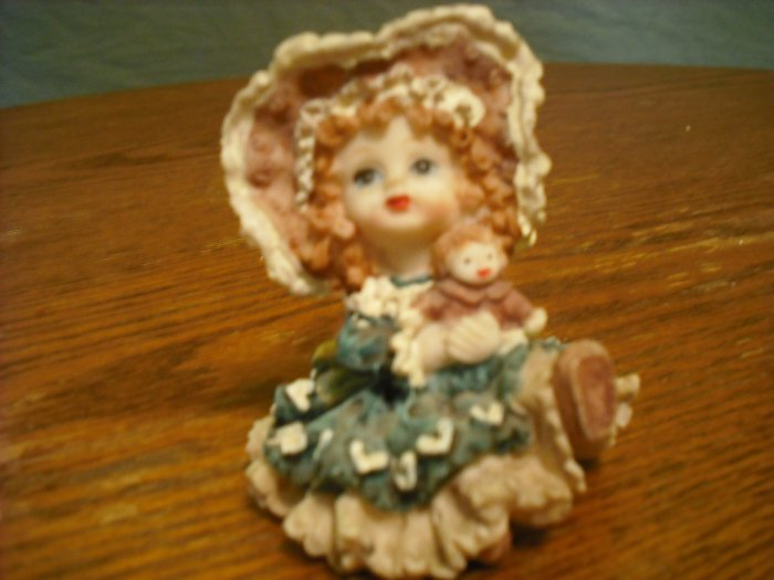 Little girl with doll figurine