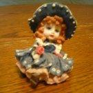 Little girl with flower figurine