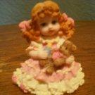 little girl with bear figurine