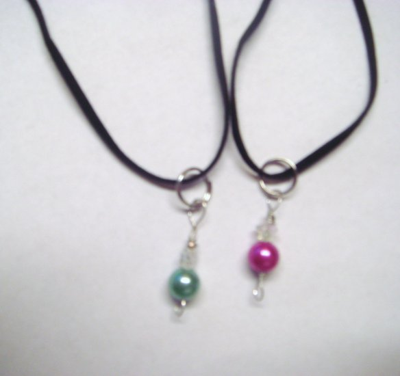 set of purple and green bead necklaces