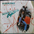 GLENN FREY~The Heat is on / Shoot Out~ MCA MCA-52512 1984, 45