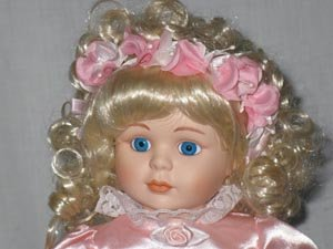 Flower Girl Porcelain Doll by Dynasty