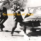 Robert Vaughn and David McCallum - Man From U.N.C.L.E. b/w photo - (gun action by car)