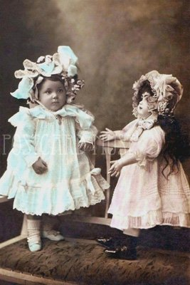 GIRL WITH A BISQUE DOLL Antique Photo Postcard Reproduction