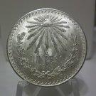 1943 #13 Unc.  Mexican Un Peso Silver Dollar.
