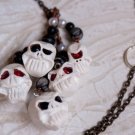 Laughing Skull Lariat with Marble, Obsidian, and Pearl