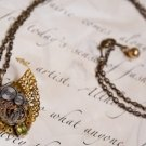 Angel Wing Filigree Necklace with Antique Watch Movement and Peridot