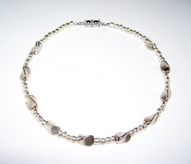 Silver Anklet with flat presses round barrels