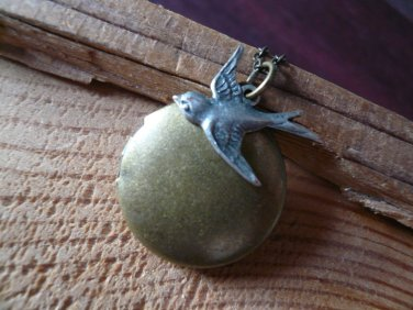 Sparrow's Journey Bird Round Locket Necklace