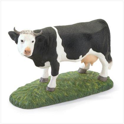 PORCELAIN COW FIGURINE