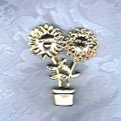 PRICES SLASHED-VINTAGE GOLDTONE FACE FLOWERS IN POT BROOCH PIN