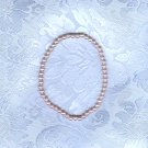 PRICES SLASHED-VINTAGE PALE PINK FAUX PEARL STRETCHY BRACELET