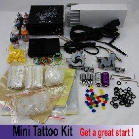 2 pcs 10 X Mini tattoo kit: LCD power 2 grips 2 gun 50 needles 5 tips