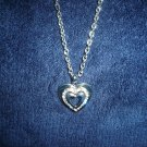 Silvertoned heart cutout w/crystal detailing necklace