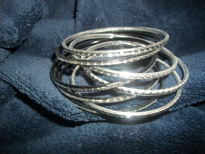 Mix of silver and black loose bangle bracelets