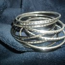 Mix of silver and black loose bangle bracelets
