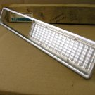 1974 Bonneville Catalian parking lamp bezel NOS right