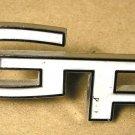 """1965 Pontiac Grand Prix NOS """" GP"""" Hood Emblem GM"""