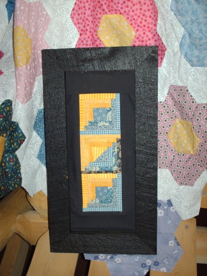 Blue and Yellow Log cabin quilt framed stitchery
