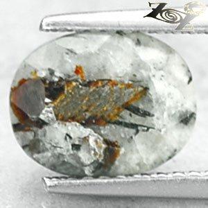 3.17 CT.Natural Oval 7.5*10 mm. Spark Orange Plates Matrix Russia Astrophylite