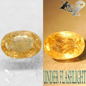 2.32 CT.Natural Oval 6.5*9 mm. Intense Lilac Yellow Color Shift Ferro Axinite