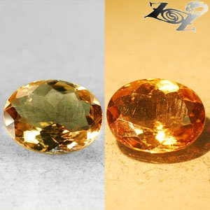 4.09 Ct.High Quality Natural Oval 10*12 mm. Color Shift Salmon Brown France Ferro Axinite