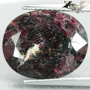 9.39 Ct.Natural Oval 12*15 mm. Black Patch Magenta Red White Eudialyte