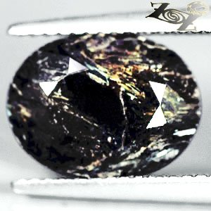 4.94 CT.Natural Oval 9*12 mm. Spark Gold Yellow Schiller Streaks Whole Nuummite