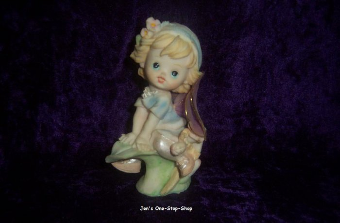 5 inch tall Angel figurine, with purple wings
