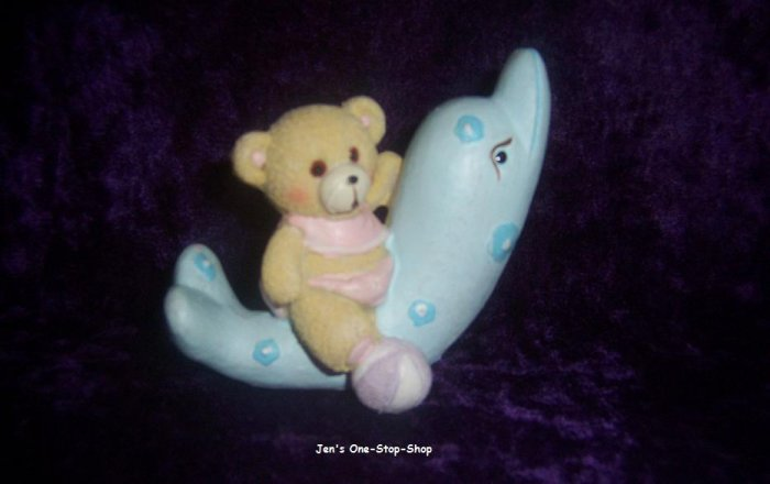 Bear and dolphin figurine