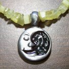 Yellow Cat's Eye Necklace with Pewter Happy Singing Moon