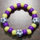 "Acrylic Purple & Yellow Soccer Ball Sport Stretch Bracelet 5.5"""
