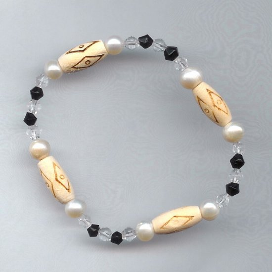White Freshwater Pearl, Black, Crystal, Carved Bone Accent Beads Stretch Bracelet