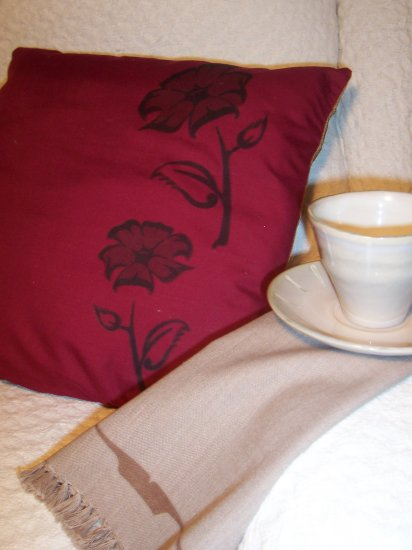 pair burgundy cushions with native design by Gina