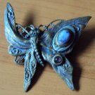 Butterfly pin with purple semi-precious stones