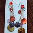 Colorful shells and silver dangly earrings
