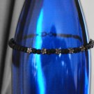 Black beaded anklet with silver flowers