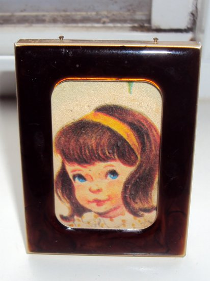 Vintage tortoise shell picture frame with little girl pic