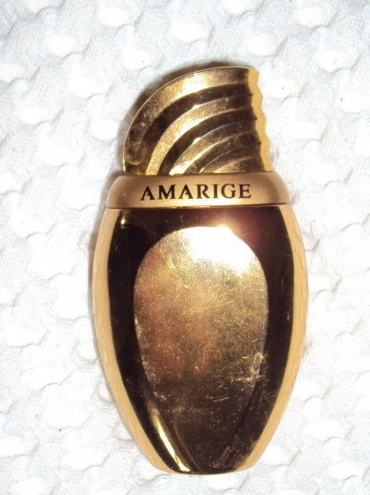 Gold plated refillable Amarige bottle from Givenchy