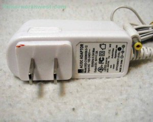 XKD-C1500NHS9.0-12 AC Power Adapter 9VDC 1.5A Supply