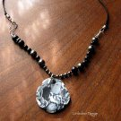 Handmade obsidian, hematite, and poly clay focal necklace
