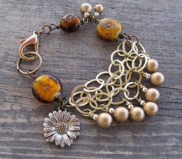 Handmade gold lampworked glass and glass pearls with sunflower charm bracelet
