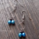 Handmade electric blue pearl earrings on silver earwires