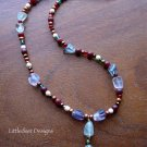 Handmade Rainbow Fluorite, copper pearl, and bone bead necklace