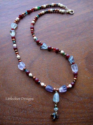Handmade Rainbow Fluorite, copper pearl, and bone bead necklace