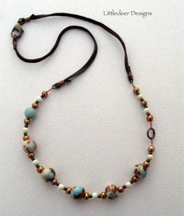 Handmade aqua, terra cotta, and brown ceramic bead necklace