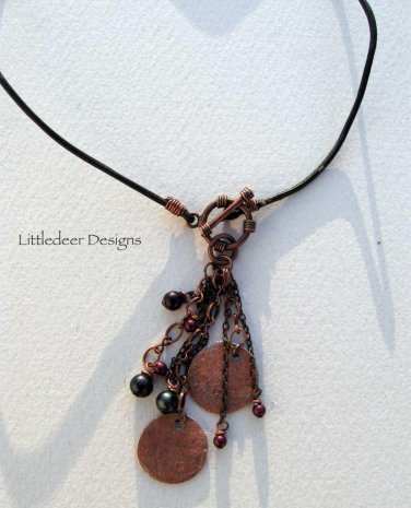 Handmade hammered and textured copper focals on black leather cord