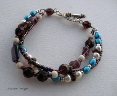 Handmade 3-strand electric blue, ivory, and amethyst bracelet