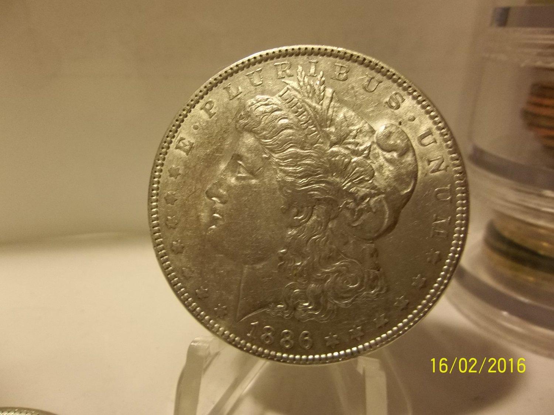 1886 #6 90% Silver Morgan Dollar.